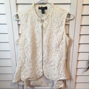 Elegant lace blouse with clasps down front. Flare.